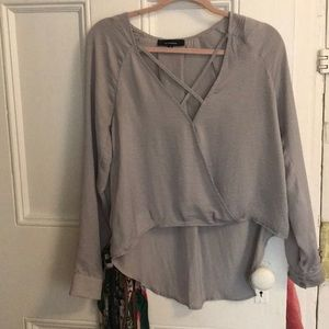 LIKE NEW silver top with criss crossed front